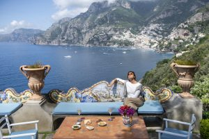 Woman having an aperitiv in the terrace of Hotel Il San Pietro di Positano,Relais & Chateaux on the Amalfi coast
