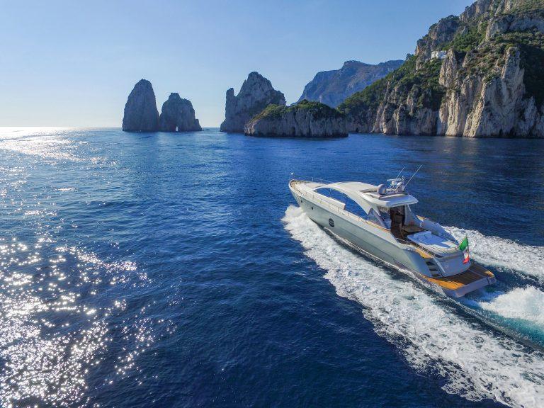 Boat and Faraglioni