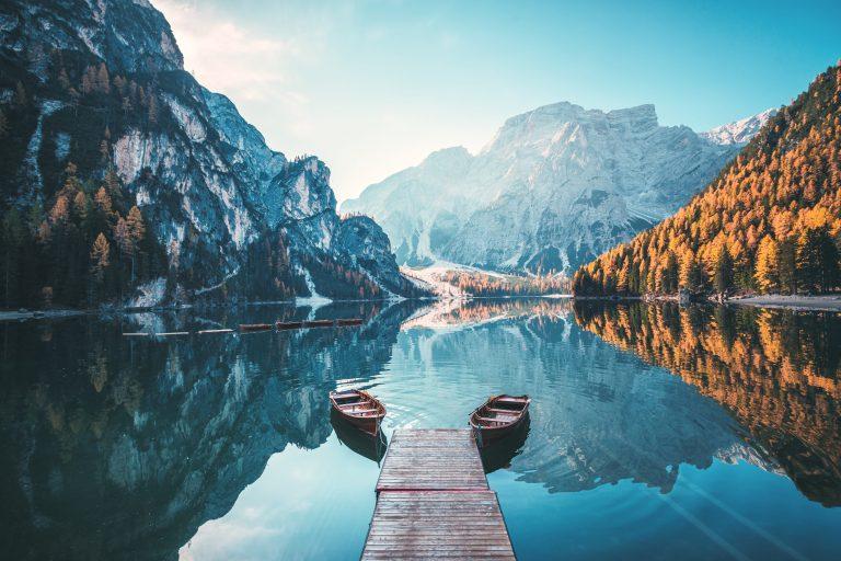 Boats on Lake Braies Dolomites mountains