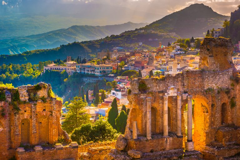 The ruins of the Taormina Theater at sunset.