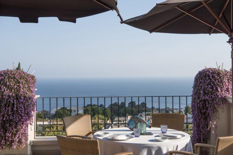 Set tables for dinner at Terrazza Tiberio Restaurant, Capri Tiberio Palace in Capri