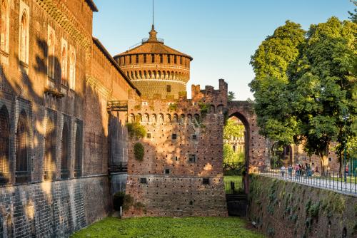 Sforza,Castle,(castello,Sforzesco),With,Moat,In,Summer,,Milan,,Italy.