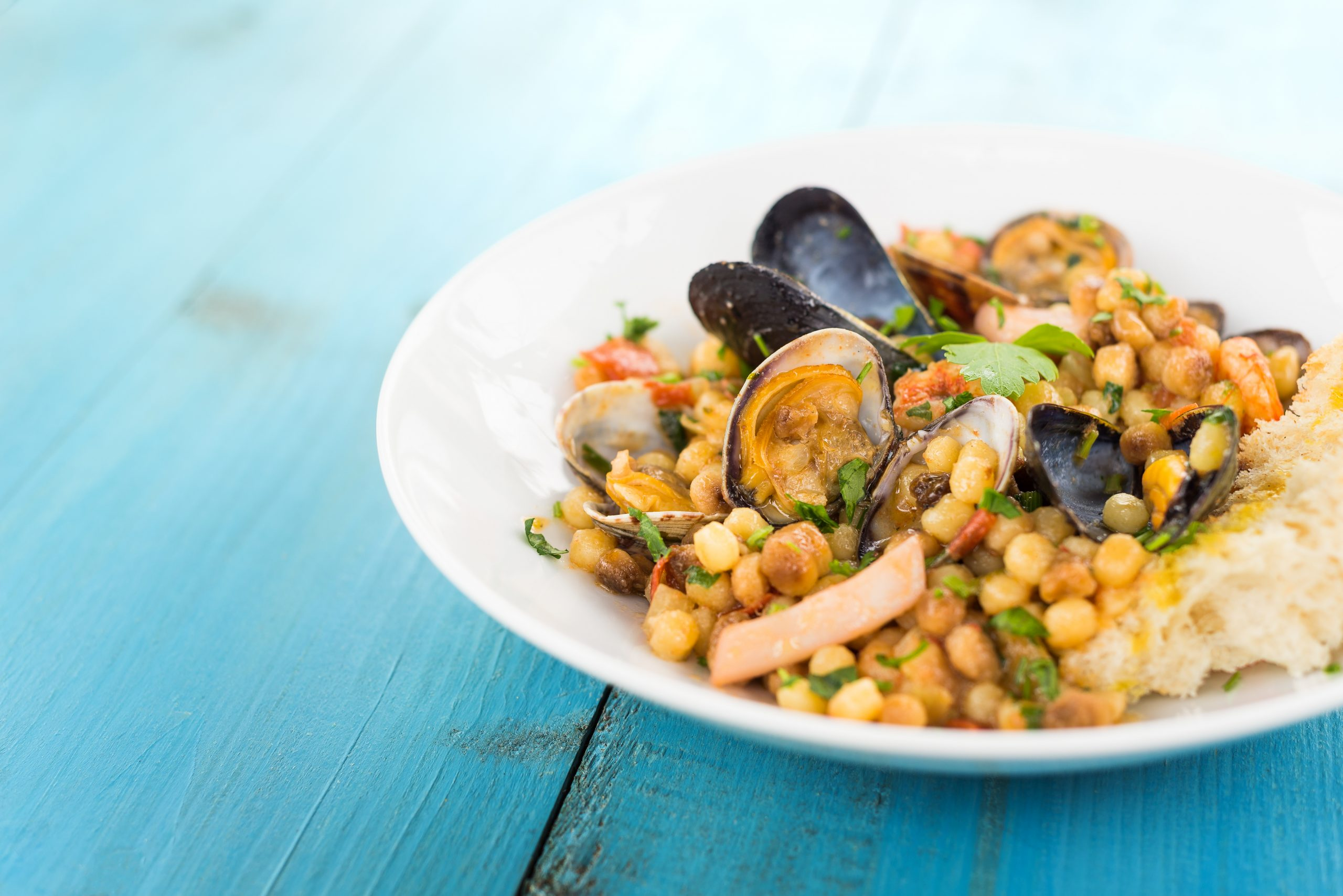Fregula,With,Seafood,,Traditional,Sardinian,Recipe,With,Durum,Wheat,Semolina